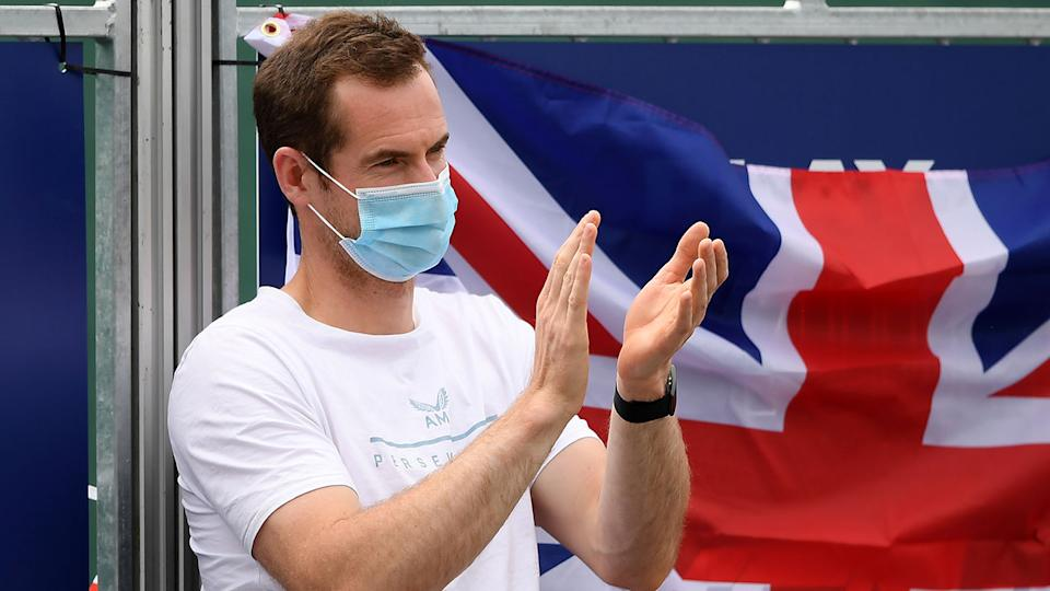 Seen here, British tennis star Andy Murray applauds at the side of the court.