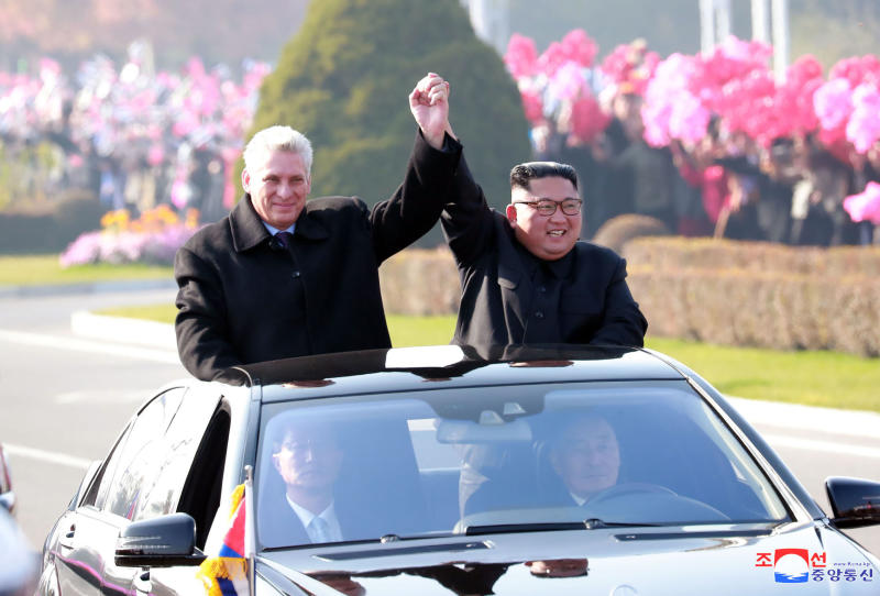 "In this Sunday, Nov. 4, 2018 photo released by the North Korean government, Cuban President Miguel Diaz-Canel, left, raises joined hands with North Korean leader Kim Jong Un from a car upon arrival in Pyongyang, North Korea. Both, hoping to get out from under U.S. economic sanctions, agreed to expand and strengthen their strategic relations, North Korea's state media reported Monday, Nov. 5, 2018. Independent journalists were not given access to cover the event depicted in this image distributed by the North Korean government. The content of this image is as provided and cannot be independently verified. Korean language watermark on image as provided by source reads: ""KCNA"" which is the abbreviation for Korean Central News Agency. (Korean Central News Agency/Korea News Service via AP)"