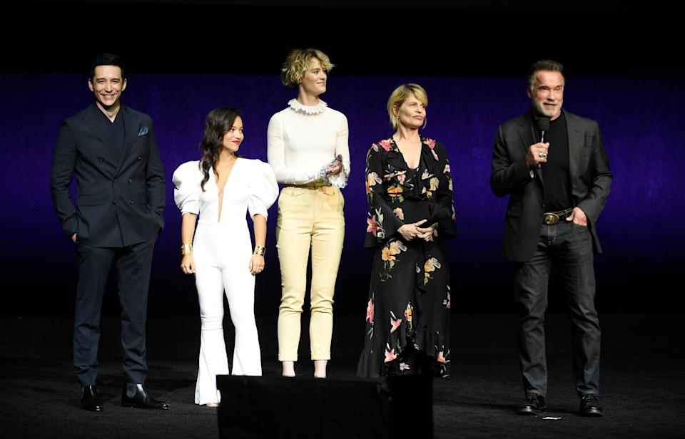 """Gabriel Luna, from left, Natalia Reyes, Mackenzie Davis, Linda Hamilton and Arnold Schwarzenegger, cast members in the upcoming film """"Terminator: Dark Fate,"""" discuss the film during the Paramount Pictures presentation at CinemaCon 2019, the official convention of the National Association of Theatre Owners (NATO) at Caesars Palace, Thursday, April 4, 2019, in Las Vegas. (Photo by Chris Pizzello/Invision/AP)"""