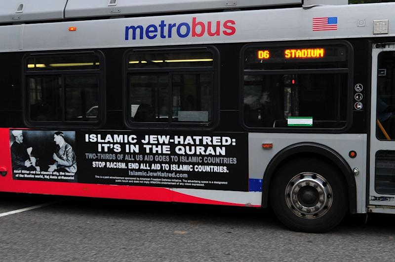 A Metro bus, featuring a controversial ad, drives on a street in Washington, DC on May 21, 2014 (AFP Photo/Karen Bleier)