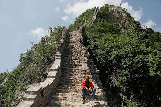 <p>A man rests while working on the reconstruction of the Jiankou section of the Great Wall, located in Huairou District, north of Beijing, China, June 7, 2017. (Photo: Damir Sagolj/Reuters) </p>