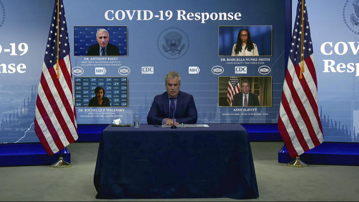 In this image from video,  Jeff Zients, White House coronavirus response coordinator, speaks as Dr. Anthony Fauci, director of the National Institute of Allergy and Infectious Diseases and chief medical adviser to the president., Dr. Marcella Nunez-Smith, chair of the COVID-19 health equity task force, Dr. Rochelle Walensky, director of the Centers for Disease Control and Prevention, and Andy Slavitt, senior adviser to the White House COVID-19 Response Team, appear on screen during a White House briefing on the Biden administration's response to the COVID-19 pandemic Wednesday, Jan. 27, 2021, in Washington. (White House via AP)