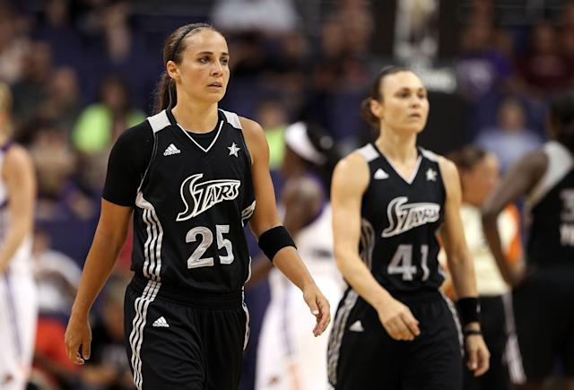 PHOENIX, AZ - AUGUST 20: Becky Hammon #25 and Tully Bevilaqua #41 of the San Antonio Silver Stars walk back to their bench during the WNBA game against the Phoenix Mercury at US Airways Center on August 20, 2011 in Phoenix, Arizona. The Mercury defeated the Silver Stars 87-81. NOTE TO USER: User expressly acknowledges and agrees that, by downloading and or using this photograph, User is consenting to the terms and conditions of the Getty Images License Agreement. (Photo by Christian Petersen/Getty Images)