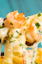 """<p>Prawns tossed in an easy from-scratch Alfredo sauce and penne and baked until you have cheesy goodness. </p><p>Get the <a href=""""https://www.delish.com/uk/cooking/recipes/a32014444/garlicky-alfredo-shrimp-bake-recipe/"""" rel=""""nofollow noopener"""" target=""""_blank"""" data-ylk=""""slk:Garlicky Prawn Alfredo Bake"""" class=""""link rapid-noclick-resp"""">Garlicky Prawn Alfredo Bake</a> recipe.</p>"""
