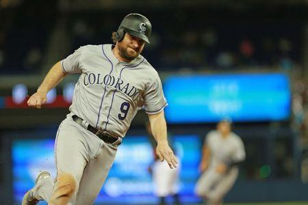 FILE PHOTO - Mar 29, 2019; Miami, FL, USA; Colorado Rockies second baseman Daniel Murphy (9) runs around third base after an RBI single by shortstop Trevor Story (not pictured) in the ninth inning of the game at Marlins Park. Mandatory Credit: Sam Navarro-USA TODAY Sports