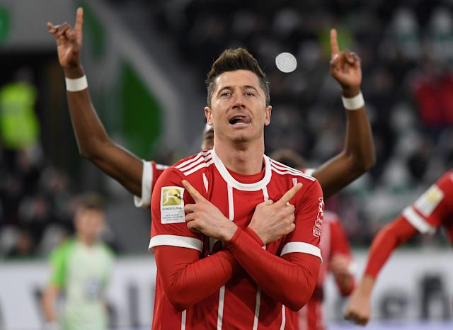 Soccer Football - Bundesliga - VfL Wolfsburg vs Bayern Munich - Volkswagen Arena, Wolfsburg, Germany - February 17, 2018 Bayern Munich's Robert Lewandowski celebrates scoring their second goal REUTERS/Fabian Bimmer DFL RULES TO LIMIT THE ONLINE USAGE DURING MATCH TIME TO 15 PICTURES PER GAME. IMAGE SEQUENCES TO SIMULATE VIDEO IS NOT ALLOWED AT ANY TIME. FOR FURTHER QUERIES PLEASE CONTACT DFL DIRECTLY AT + 49 69 650050 TPX IMAGES OF THE DAY