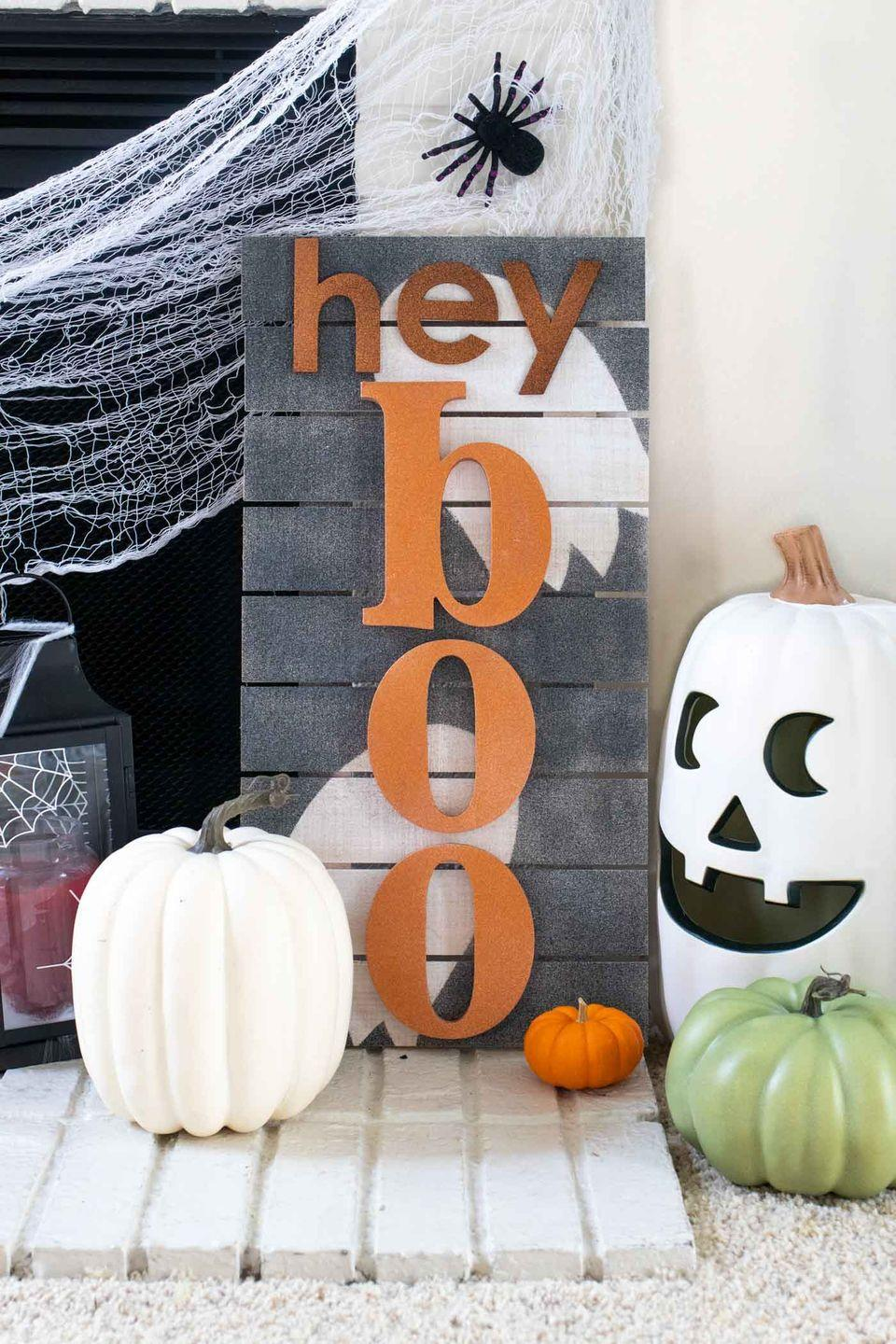 """<p>Customize a wooden sign to match your style and sense of humor. Pick your favorite Halloween pun — hey boo-tiful, for example — to outfit this timeless DIY. </p><p><em><a href=""""https://www.clubcrafted.com/punny-halloween-sign/"""" rel=""""nofollow noopener"""" target=""""_blank"""" data-ylk=""""slk:Get the tutorial at Club Crafted »"""" class=""""link rapid-noclick-resp"""">Get the tutorial at Club Crafted »</a></em></p>"""