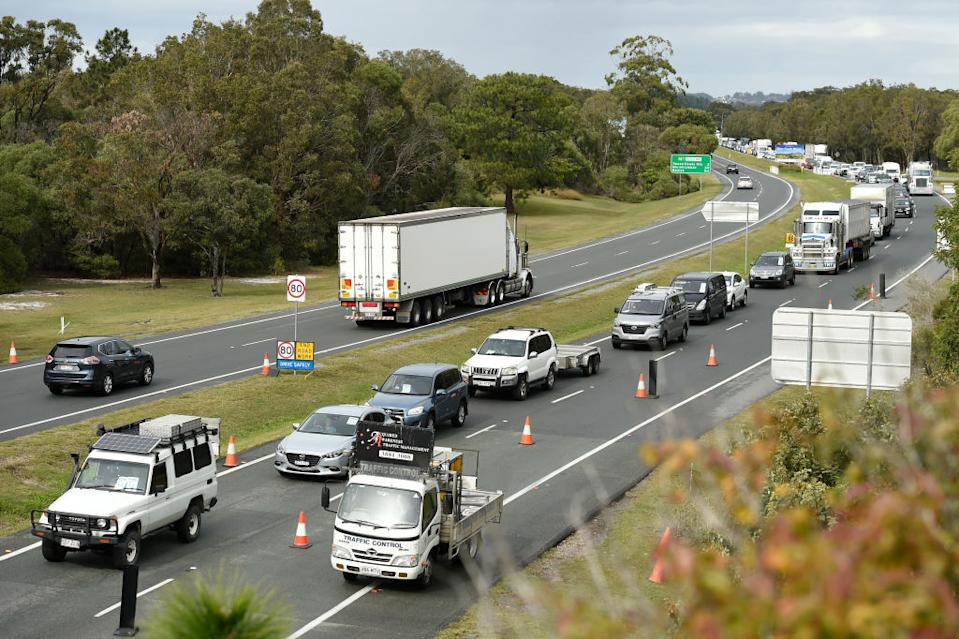 Line of cars waiting at the NSW border. Source: AAP