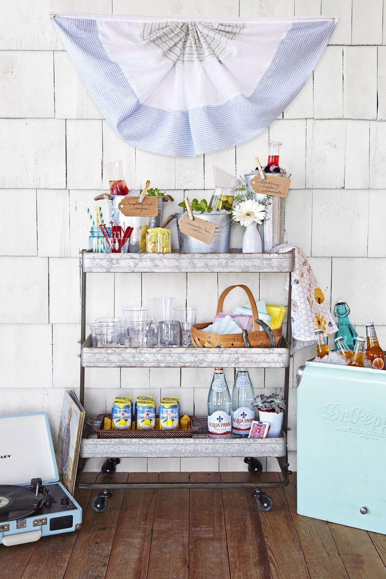 """<p>Load up a portable bar cart with all the makings for boozy summer cocktails, plus some ready-to-drink options for the kids on the run. Keep cups, stirrers and garnishes on the top shelf for easy access. </p><p><a class=""""link rapid-noclick-resp"""" href=""""https://www.amazon.com/CAXXA-3-Tier-Rolling-Storage-Organizer/dp/B07JJMYQ8G/?tag=syn-yahoo-20&ascsubtag=%5Bartid%7C10055.g.3620%5Bsrc%7Cyahoo-us"""" rel=""""nofollow noopener"""" target=""""_blank"""" data-ylk=""""slk:SHOP ROLLING CARTS"""">SHOP ROLLING CARTS</a></p><p><strong>RELATED:</strong> <a href=""""https://www.goodhousekeeping.com/home/decorating-ideas/g32596610/small-backyard-ideas/"""" rel=""""nofollow noopener"""" target=""""_blank"""" data-ylk=""""slk:The Best Small Backyard Ideas"""" class=""""link rapid-noclick-resp"""">The Best Small Backyard Ideas </a></p>"""
