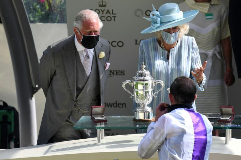 Prince Charles and wife Camilla present the trophy for the St James's Palace Stakes at Royal Ascot to jockey Kevin Manning