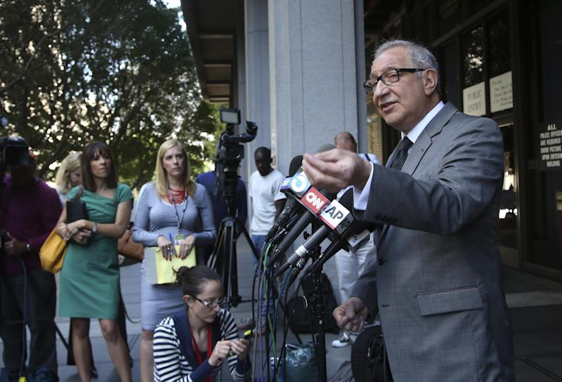 R&B singer Chris Brown's attorney Mark Geragos, right, talks to reporters outside Los Angeles Superior Court on Monday, March 17, 2014. Brown will spend another month in jail after a judge said Monday he was told the singer made troubling comments in rehab about being good at using guns and knives. Brown was arrested on Friday, March 14, 2014, after he was dismissed from a Malibu facility where he was receiving treatment for anger management, substance abuse and issues related to bipolar disorder. (AP Photo/Nick Ut)