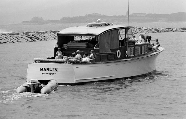 <p>Sen. Edward Kennedy, dark glasses, chats with members of family and guests of the yacht Marlin during cruise off Hyannis Port on July 29, 1969. Kennedy has been in seclusion at his Squaw Island home, on Cape Cod awaiting response of the people of Massachusetts to help him decide whether to resign from the senate. He pleaded guilty to leaving the scene of an accident on Chappaquiddick Island in which passenger was killed. (Photo: Bill Chaplis/AP) </p>