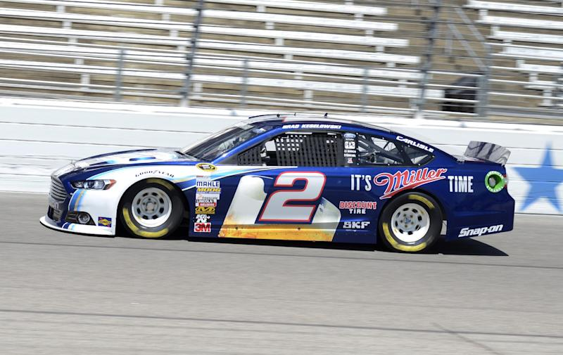 Driver Brad Keselowski comes out of turn four during practice for the NASCAR Sprint Cup series NRA 500 auto race at Texas Motor Speedway, Friday April 12, 2013, in Fort Worth, Texas. (AP Photo/Larry Papke)