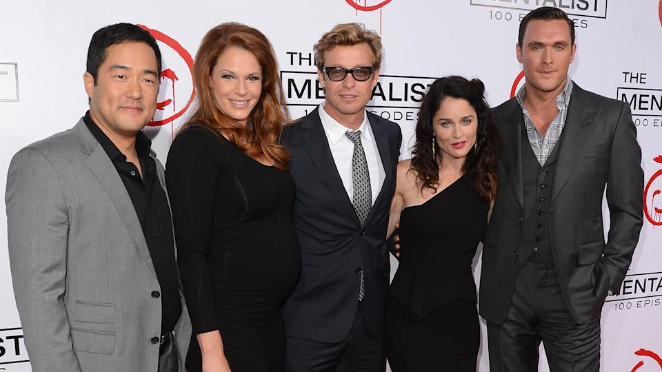 """LOS ANGELES, CA - OCTOBER 13:  Actors Tim Kang, Amanda Righetti, Simon Baker, Robin Tunney, and Owain Yeoman attend the CBS 100 episode celebration of """"The Mentalist"""" held at The Edison on October 13, 2012 in Los Angeles, California."""