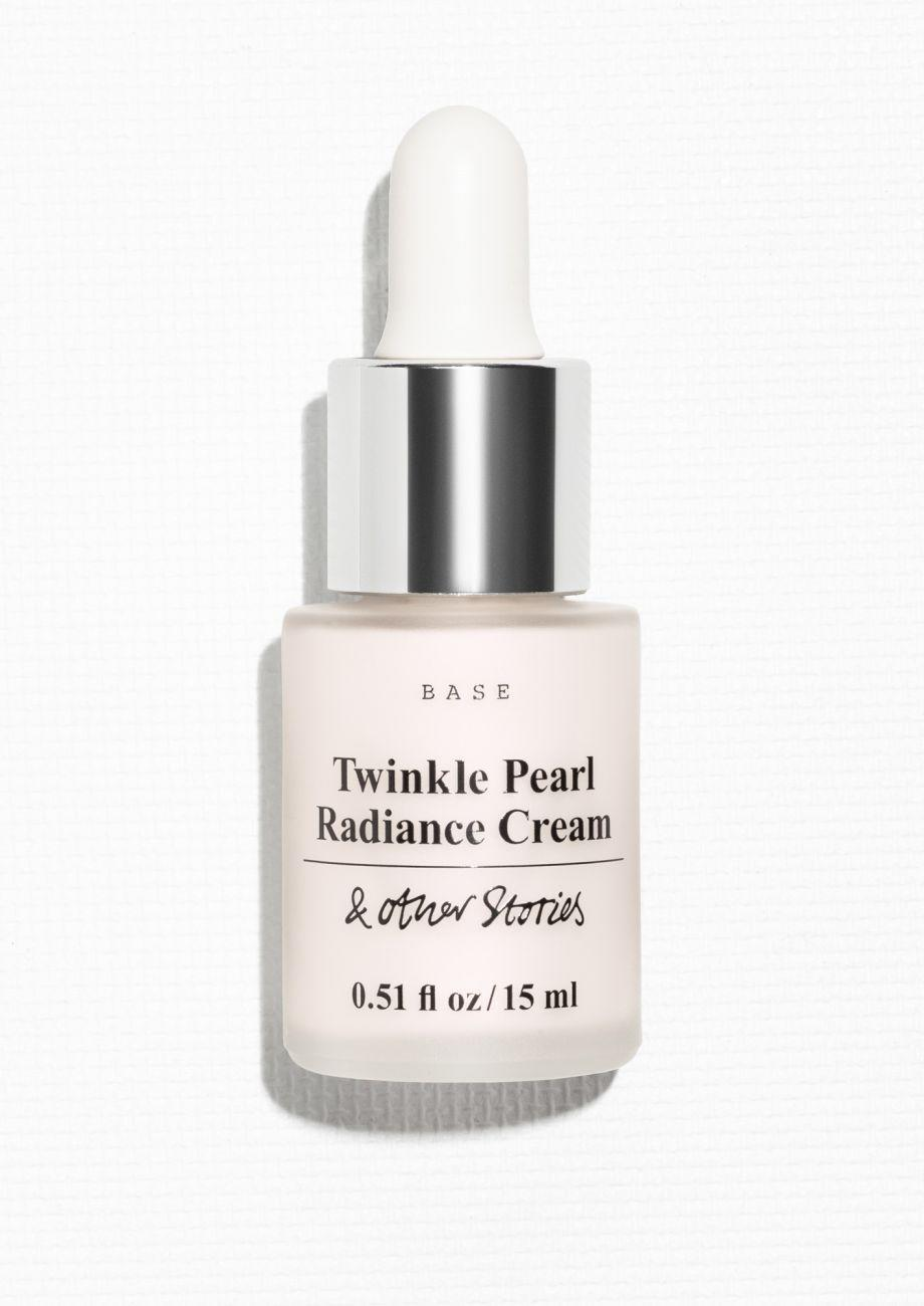 """<p>This easy-to-use highlighting cream adds shimmer to skin with just a few drops. Wear it over or under foundation for a lit-from-within glow. <a href=""""http://www.stories.com/us/AllProducts/Radiance_Cream/6085003-101451823.1#c-22755"""" rel=""""nofollow noopener"""" target=""""_blank"""" data-ylk=""""slk:& Other Stories Twinkle Pearl Radiance Cream"""" class=""""link rapid-noclick-resp"""">& Other Stories Twinkle Pearl Radiance Cream</a> ($28) </p>"""