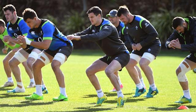 Ireland's rugby union player Johnny Sexton (C) and tammates stretch during a training session in Melbourne, on June 14, 2018, ahead of their second Test match against Australia (AFP Photo/WILLIAM WEST)