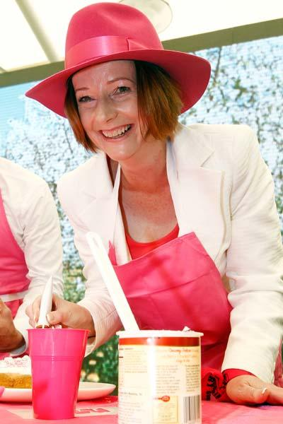 SYDNEY, AUSTRALIA - JANUARY 05:  Australian Prime Minister Julia Gillard makes a cake she made at a Jane McGrath High Tea during day three of the Second Test Match between Australia and India at Sydney Cricket Ground on January 5, 2012 in Sydney, Australia.  (Photo by Mark Metcalfe/Getty Images)