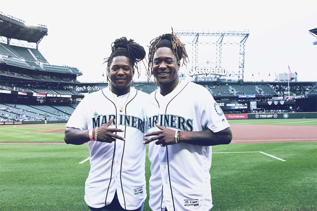 Seahawks linebacker Shaquem Griffin threw out the first pitch at the Mariners game against the Royals on Friday night to his brother, Shaquill. (Twitter/@Seahawks)