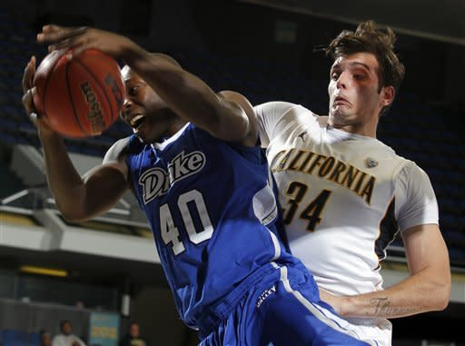 Drake forward Daddy Ugbede (40) pulls down a rebound colliding into California forward Robert Thurman (34) during the first half of their NCAA college basketball game in the first round of the DirecTV Classic in Anaheim, Calif., Thursday, Nov. 22, 2012. (AP Photo/Alex Gallardo)