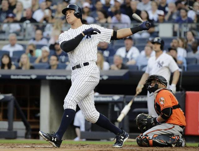 Aaron Judge watches his first-inning home run sail out against the Orioles. (AP)