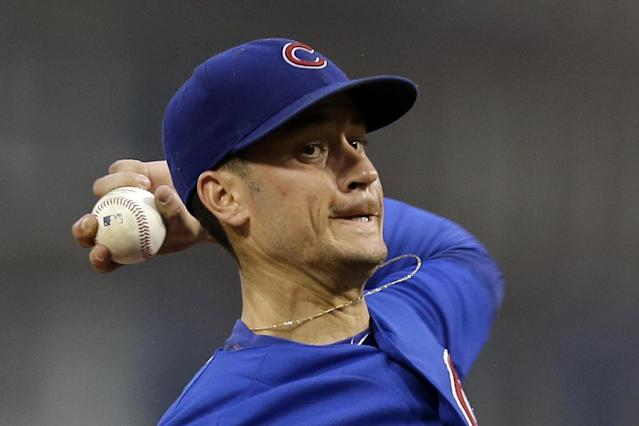 Chicago Cubs starting pitcher Chris Rusin delivers during the first inning of a baseball game against the Pittsburgh Pirates in Pittsburgh, Thursday, Sept. 12, 2013. (AP Photo/Gene J. Puskar)
