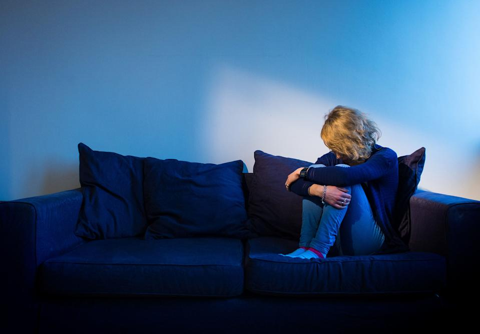 """Embargoed to 0001 Sunday July 26 PICTURE POSED BY MODEL File photo dated 09/03/15 of a woman showing signs of depression. The Scottish Government is being urged to publish data on suicides more regularly, amid fears the coronavirus pandemic could spark a """"tidal wave"""" of mental health problems."""