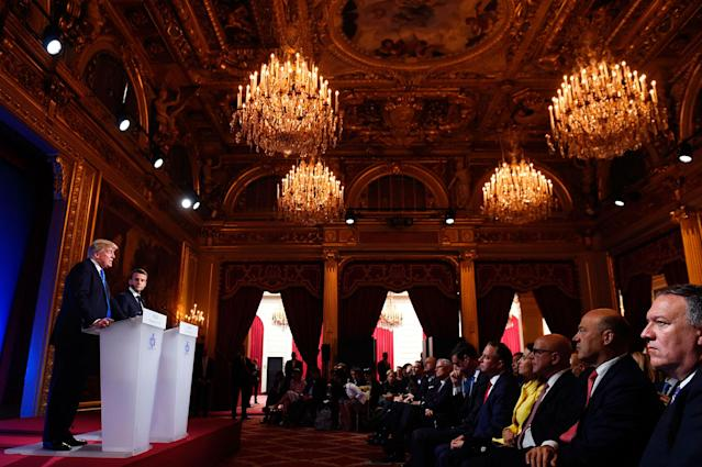 <p>French President Emmanuel Macron (2nd L) and President Donald Trump (L) hold a press conference following meetings at the Elysee Palace in Paris, on July 13, 2017. (Photo: Saul Loeb/AFP/Getty Images) </p>