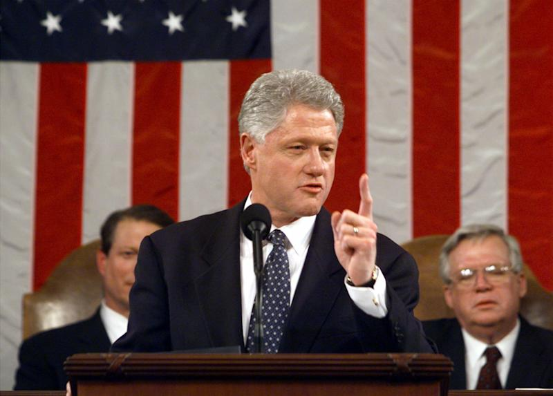 """FILE - In this Jan. 19, 1999 file-pool photo, President Bill Clinton gestures while giving his State of the Union address on Capitol Hill in Washington. Is """"strong"""" losing its strength? Presidents of both parties have long felt compelled to sum up the state of the union with a descriptive word or two in their State of the Union addresses. Mostly the same word. For many years now, """"strong"""" has been the go-to adjective. Vice President Gore, left, and House Speaker Dennis Hastert of Ill. listen. (AP Photo/Win McNamee, File-Pool)"""