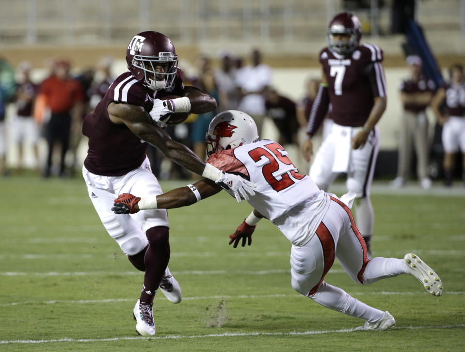 Texas A&M wide receiver Ricky Seals-Jones, left, breaks away from Lamar defensive back Tommie Barrett (25) after catching pass to run for a touchdown during the first quarter of an NCAA college football game Saturday, Sept. 6, 2014, in College Station, Texas. (AP Photo/David J. Phillip)