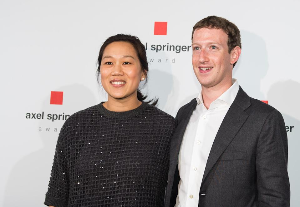 BERLIN, GERMANY - FEBRUARY 25: (r-l) Mark Zuckerberg, CEO and founder of the social media platform Facebook, and his wife Priscilla Chan pose for a photo before the Axel-Springer-Award on February 25, 2016 in Berlin. Mark Zuckerberg got this first time awarding price for special innovations. (Photo by Florian Gaertner/Photothek via Getty Images)