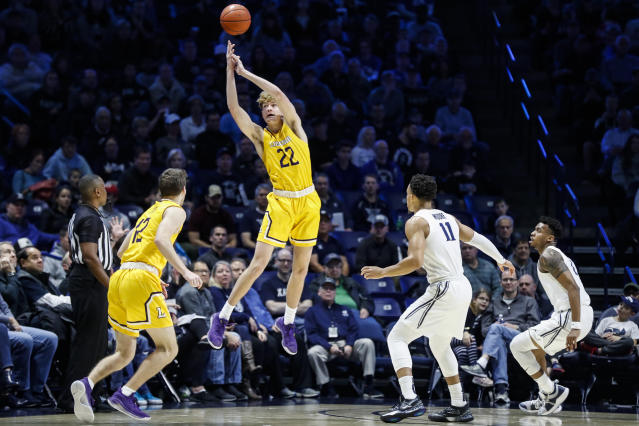 Lipscomb's Jacob Hobbs (22) reaches for a wild pass against Xavier's Bryce Moore (11) during the first half of an NCAA college basketball game, Saturday, Nov. 30, 2019, in Cincinnati. (AP Photo/John Minchillo)