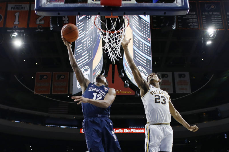 Georgetown's Terrell Allen, left, goes up for a shot against Villanova's Jermaine Samuels during the first half of an NCAA college basketball game, Saturday, Jan. 11, 2020, in Philadelphia. (AP Photo/Matt Slocum)