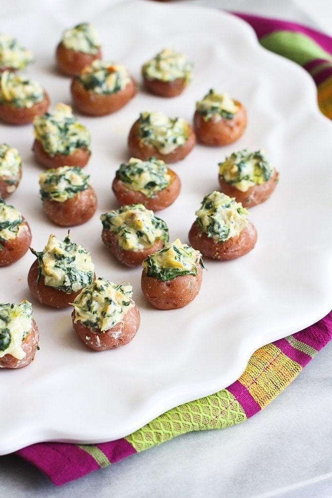 """<p>These little potatoes pack big flavor, so get ready! Since they're so small, they're pretty light, meaning you can nosh on a few before dinner and still have room to chow down. This recipe is easy to adjust, so just add in how many potatoes you want to make, and the recipe will update depending on that number. </p> <p><strong>Get the recipe:</strong> <a href=""""https://www.cookincanuck.com/mini-spinach-artichoke-stuffed-potatoes-recipe/"""" class=""""link rapid-noclick-resp"""" rel=""""nofollow noopener"""" target=""""_blank"""" data-ylk=""""slk:mini spinach-artichoke-stuffed potatoes"""">mini spinach-artichoke-stuffed potatoes</a></p>"""