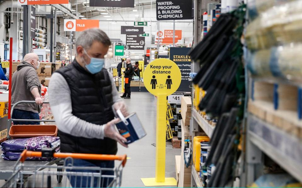 Customers maintain social distancing measures at B&Q Leyton - Hollie Adams/Getty Images Europe