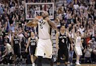 Utah Jazz point guard Mo Williams (5) celebrates after scoring the game winning shoot an the end of their NBA basketball game against the San Antonio Spurs Wednesday, Dec.12, 2012, in Salt Lake City. The Jazz defeated the Spurs 99-96. (AP Photo/Rick Bowmer)