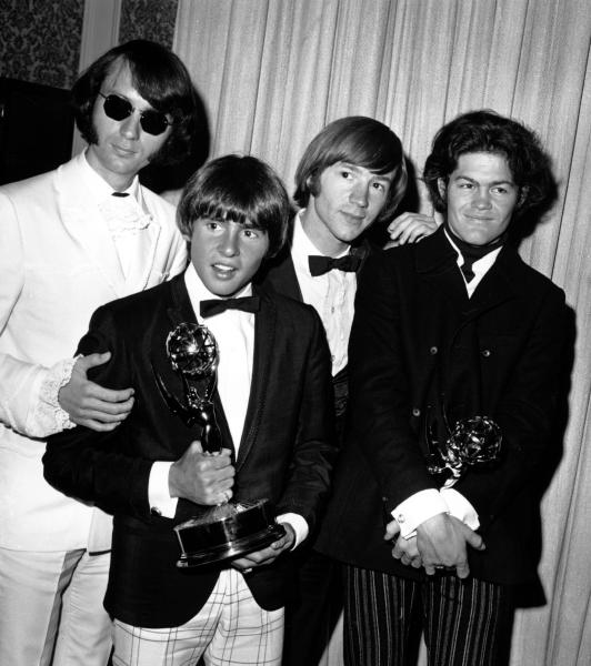 """FILE - This June 4, 1967 file photo shows The Monkees posing with their Emmy award at the 19th Annual Primetime Emmy Awards in Calif. The group members are, from left to right, Mike Nesmith, Davy Jones, Peter Tork, and Micky Dolenz. Jones died Wednesday Feb. 29, 2012 in Florida. He was 66. Jones rose to fame in 1965 when he joined The Monkees, a British popular rock group formed for a television show. Jones sang lead vocals on songs like """"I Wanna Be Free"""" and """"Daydream Believer."""" (AP Photo, File)"""