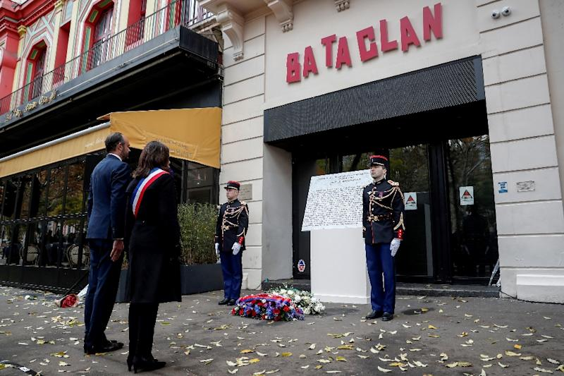 Paris Mayor Anne Hidalgo and French Prime Minister Edouard Philippe pay their respects at the entrance of the Bataclan nightclub in November 2018 as they mark three years since the deadly assault (AFP Photo/BENOIT TESSIER)