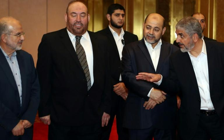 Khaled Meshaal (R) speaks with Hamas officials ahead of their conference in the Qatari capital, Doha on May 1