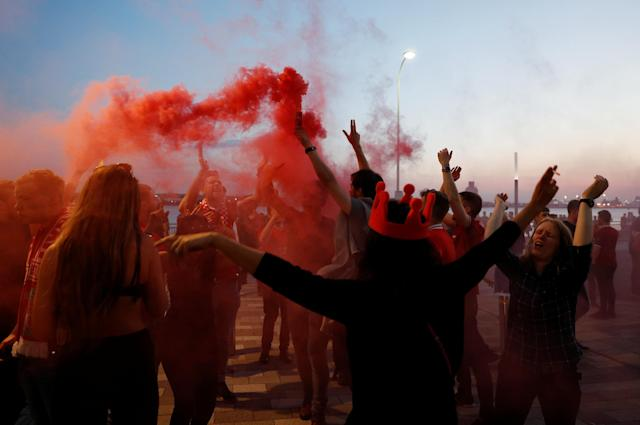 Soccer Football - Liverpool fans watch the Champions League Final - Liverpool, Britain - May 26, 2018 Liverpool fans with flares after losing the final REUTERS/Peter Nicholls