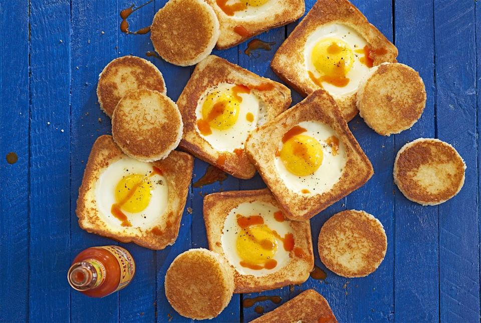 """<p>Make breakfast in bed a breeze with this egg-in-a-hole recipe—no utensils required.</p><p><strong><a href=""""https://www.countryliving.com/food-drinks/recipes/a41630/parmesan-egg-in-hole-recipe/"""" rel=""""nofollow noopener"""" target=""""_blank"""" data-ylk=""""slk:Get the recipe"""" class=""""link rapid-noclick-resp"""">Get the recipe</a>.</strong><br></p>"""