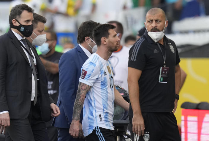 Argentina's Lionel Messi walks off the field after the qualifying soccer match for the FIFA World Cup Qatar 2022 against Brazil was interrupted by health officials in Sao Paulo, Brazil, Sunday, Sept.5, 2021. (AP Photo/Andre Penner)