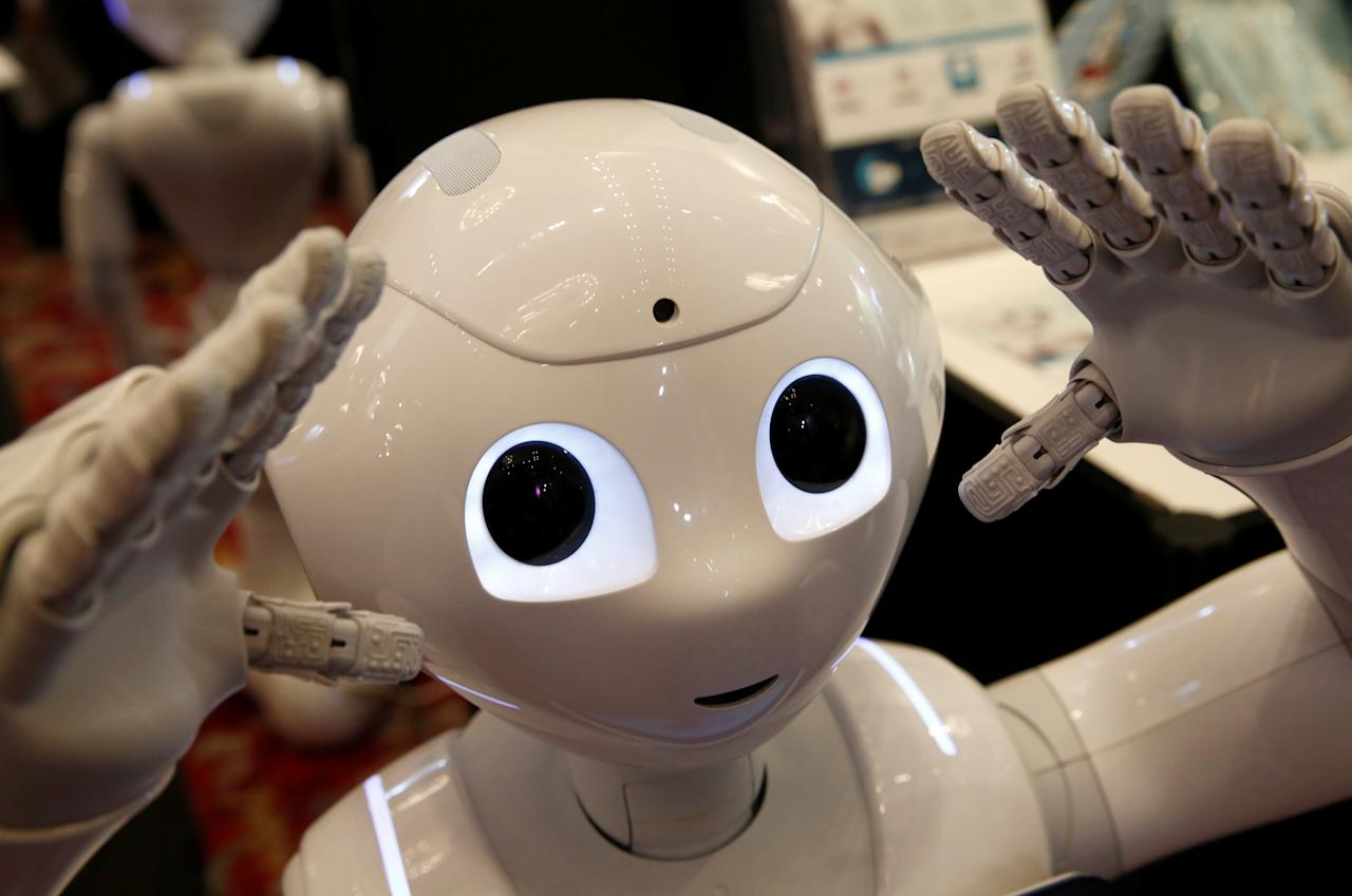 SoftBank humanoid robot known as Pepper moves its hands at Pepper World 2016 Summer during SoftBank World 2016 conference in Tokyo, Japan, July 21, 2016.  REUTERS/Kim Kyung-Hoon
