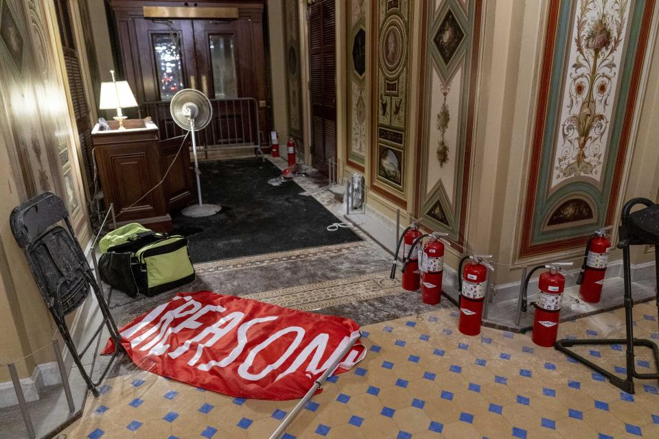 "A flag that reads ""Treason"" is visible on the ground in the early morning hours of Thursday, Jan. 7, 2021, after protesters stormed the Capitol in Washington, on Wednesday. (AP Photo/Andrew Harnik)"