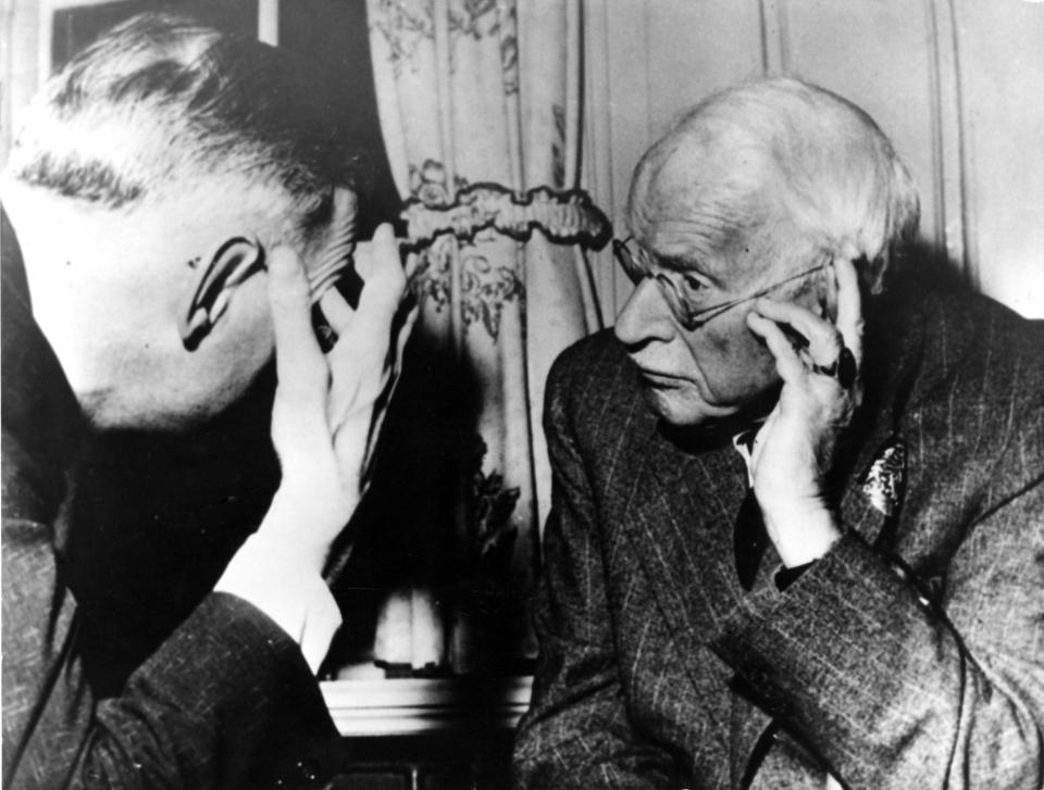 """Car Gustav Jung (85), one of the founders od modern psychiatry, completed his memoirs at his estate near Zurich. Jung, is shown here with one of his followers on July 13, 1960 in Zurich, Switzerland, inroduced the terms """"introvert"""" and """"extrovert"""" in his work defining many basic psychiatric concepts. (AP Photo)"""
