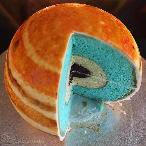 The planet's core is made from mud cake, almond butter represents a layer of liquid metallic hydrogen and the blue-colored vanilla Madeira sponge cake is representative of molecular hydrogen. Image uploaded on Aug. 27, 2013.
