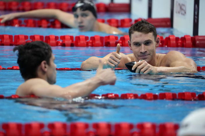 The United States' Ryan Murphy, right, gives a thumbs up to Evgeny Rylov, of Russian Olympic Committee, after Rylov won the men's 200-meter backstroke final at the 2020 Summer Olympics, Friday, July 30, 2021, in Tokyo, Japan. (AP Photo/David Goldman)