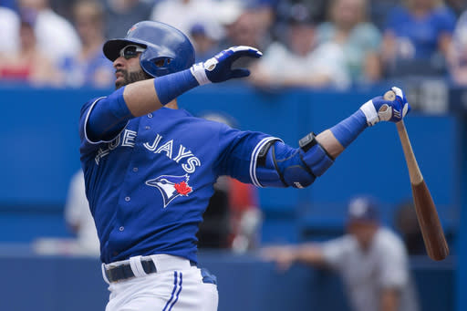 Toronto Blue Jays' Jose Bautista watches the flight of the ball after hitting a solo homer off Milwaukee Brewers starting pitcher Wily Peralta during first inning interleague baseball action in Toronto on Wednesday July 2 , 2014. (AP Photo/The Canadian Press, Chris Young)
