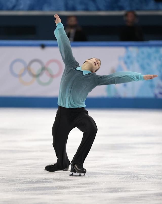 Peter Liebers of Germany competes in the men's team short program figure skating competition at the Iceberg Skating Palace during the 2014 Winter Olympics, Thursday, Feb. 6, 2014, in Sochi, Russia. (AP Photo/Ivan Sekretarev)