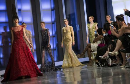 Models present creations during the J Summer Fashion Show at One World Trade Center in New York
