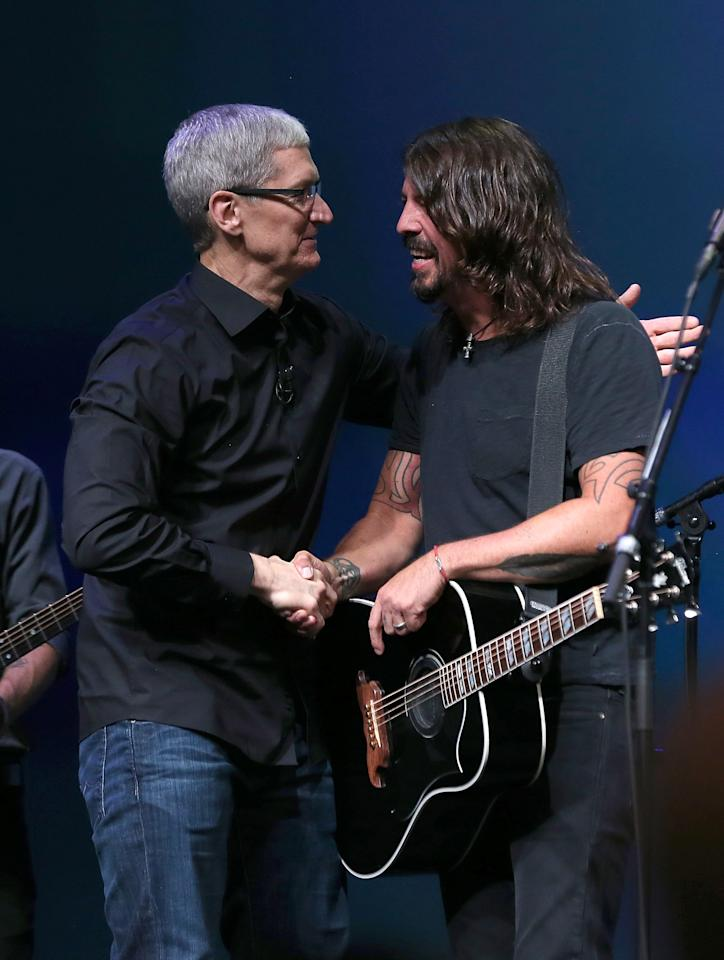 SAN FRANCISCO, CA - SEPTEMBER 12:  Apple CEO Tim Cook greets Dave Grohl of the Foo Fighters during an Apple special event at the Yerba Buena Center for the Arts on September 12, 2012 in San Francisco, California. Apple announced the iPhone 5, the latest version of the popular smart phone.  (Photo by Justin Sullivan/Getty Images)